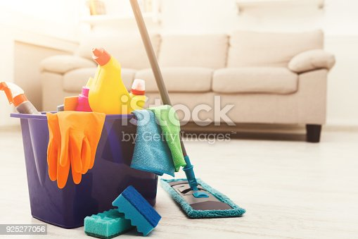 istock Bucket with sponges, chemicals bottles and mopping stick. 925277056