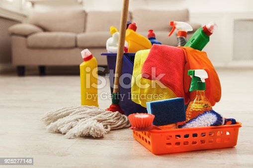 istock Bucket with sponges, chemicals bottles and mopping stick. 925277148