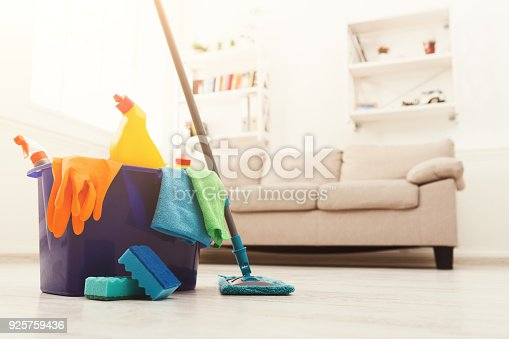 istock Bucket with sponges, chemicals bottles and mopping stick. 925759436