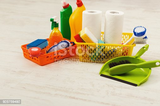 istock Bucket with sponges, chemicals bottles and mopping stick. 925759492