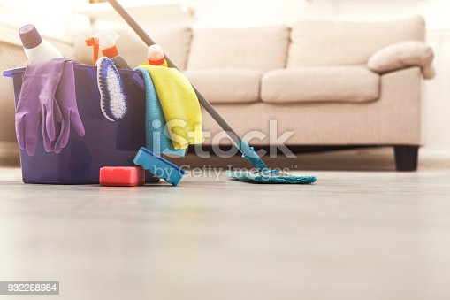 istock Bucket with sponges, chemicals bottles and mopping stick. 932268984
