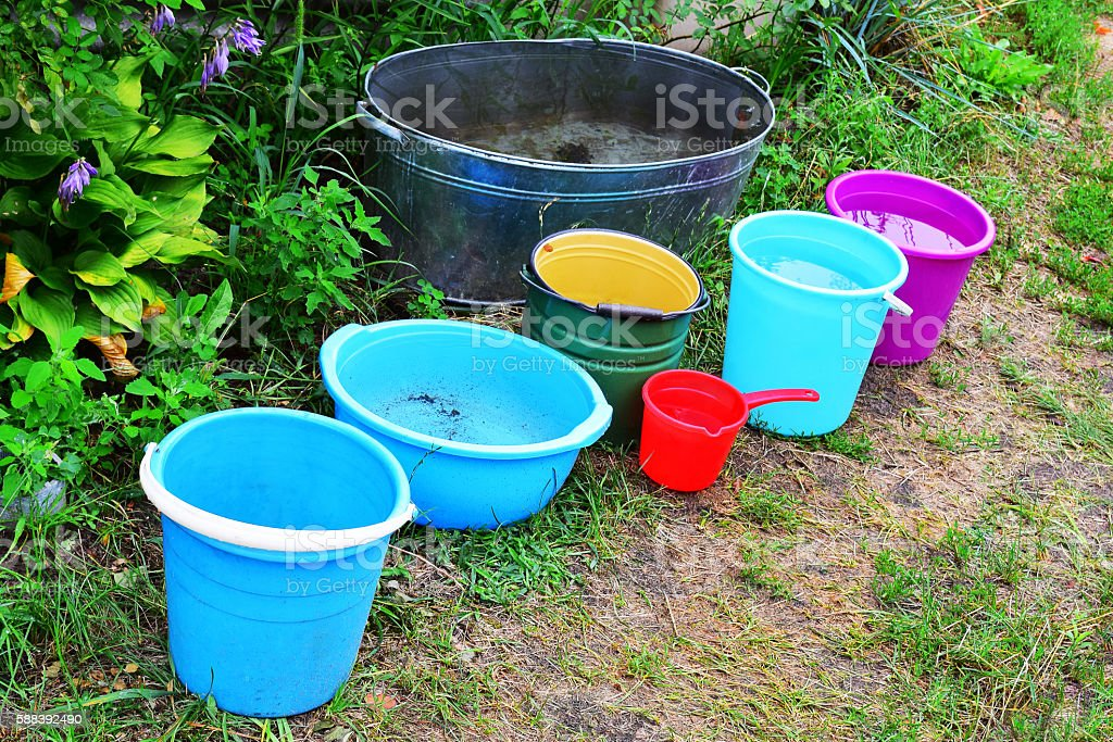 Buckets filled with water stock photo