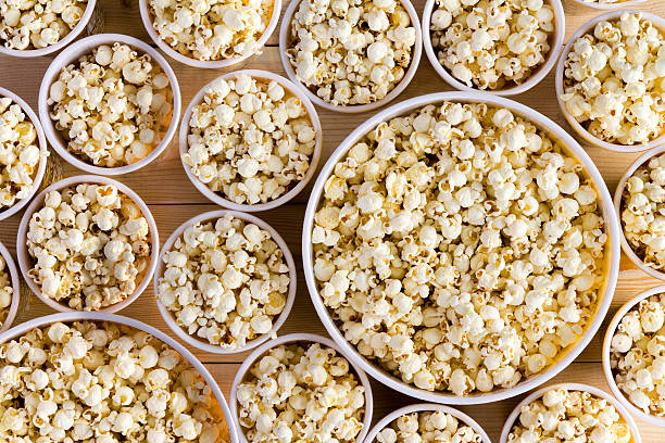 buckets full of freshly made popcorn for everyone - serving size stock photos and pictures