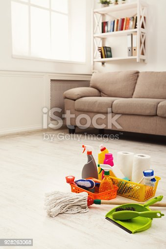 istock Buckets with sponges, chemicals bottles and mopping stick. 928263068