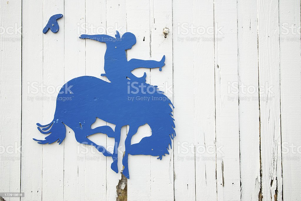Buckin Bronco Rodeo Cowboy in Blue stock photo