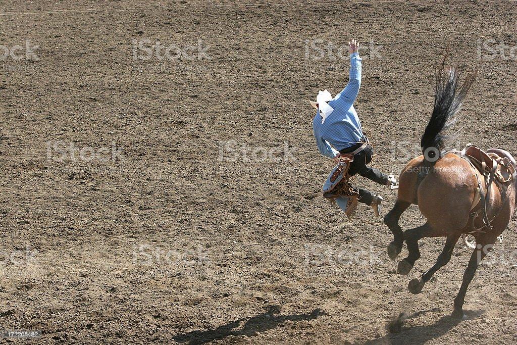 Bucking Bronco Bucked this Cowboy off. stock photo