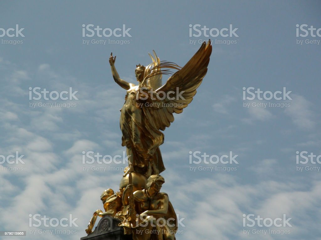 Buckingham Palace Golden Angel Statue Against Sky View In Westminster London England Europe stock photo