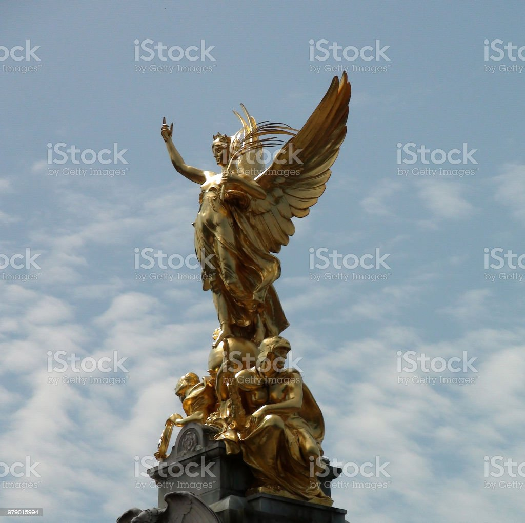Buckingham Palace Golden Angel Statue Against Sky View In Westminster. London England Europe stock photo