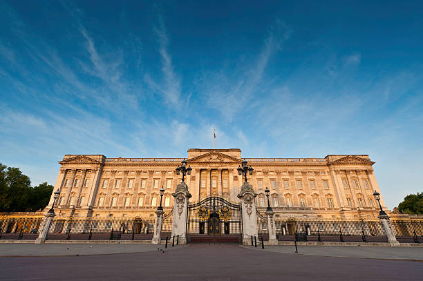 Buckingham Palace golden sunrise big blue sky London stock photo