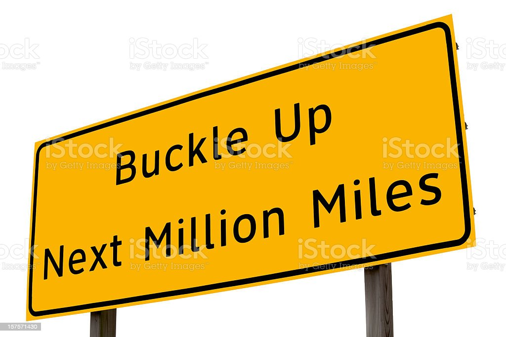 buckle up highway sign stock photo