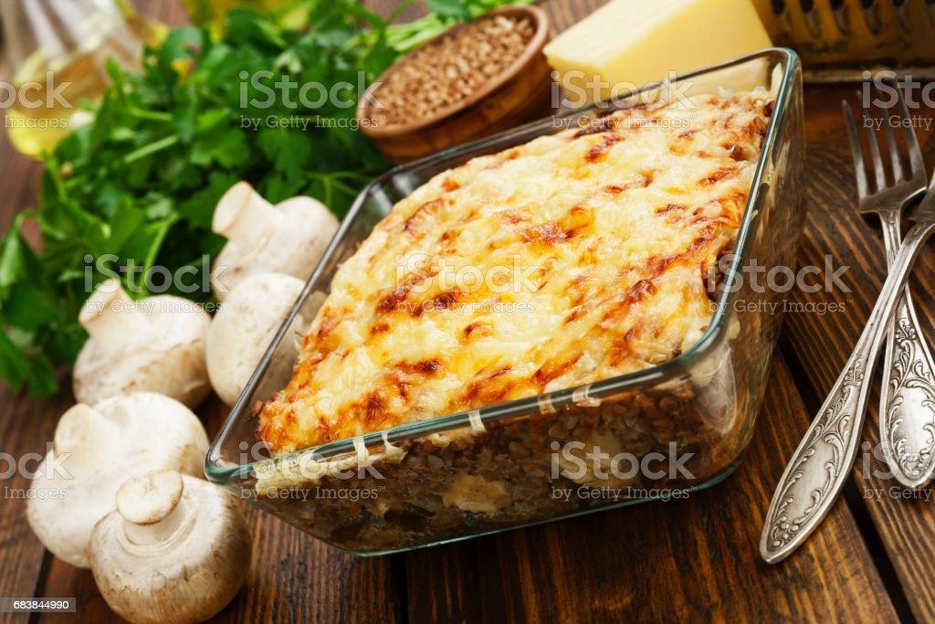 Buckwheat casserole with chicken stock photo