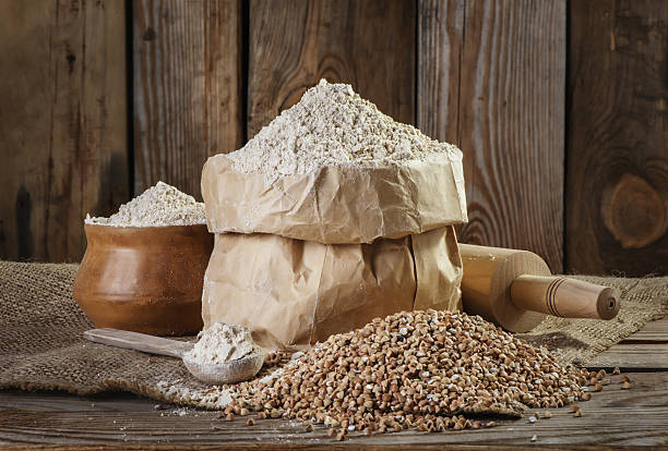 buckwheat flour  on the old wooden background closeup stock photo