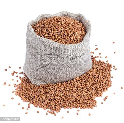 istock Buckwheat in bag isolated on white background. Closeup 873623702