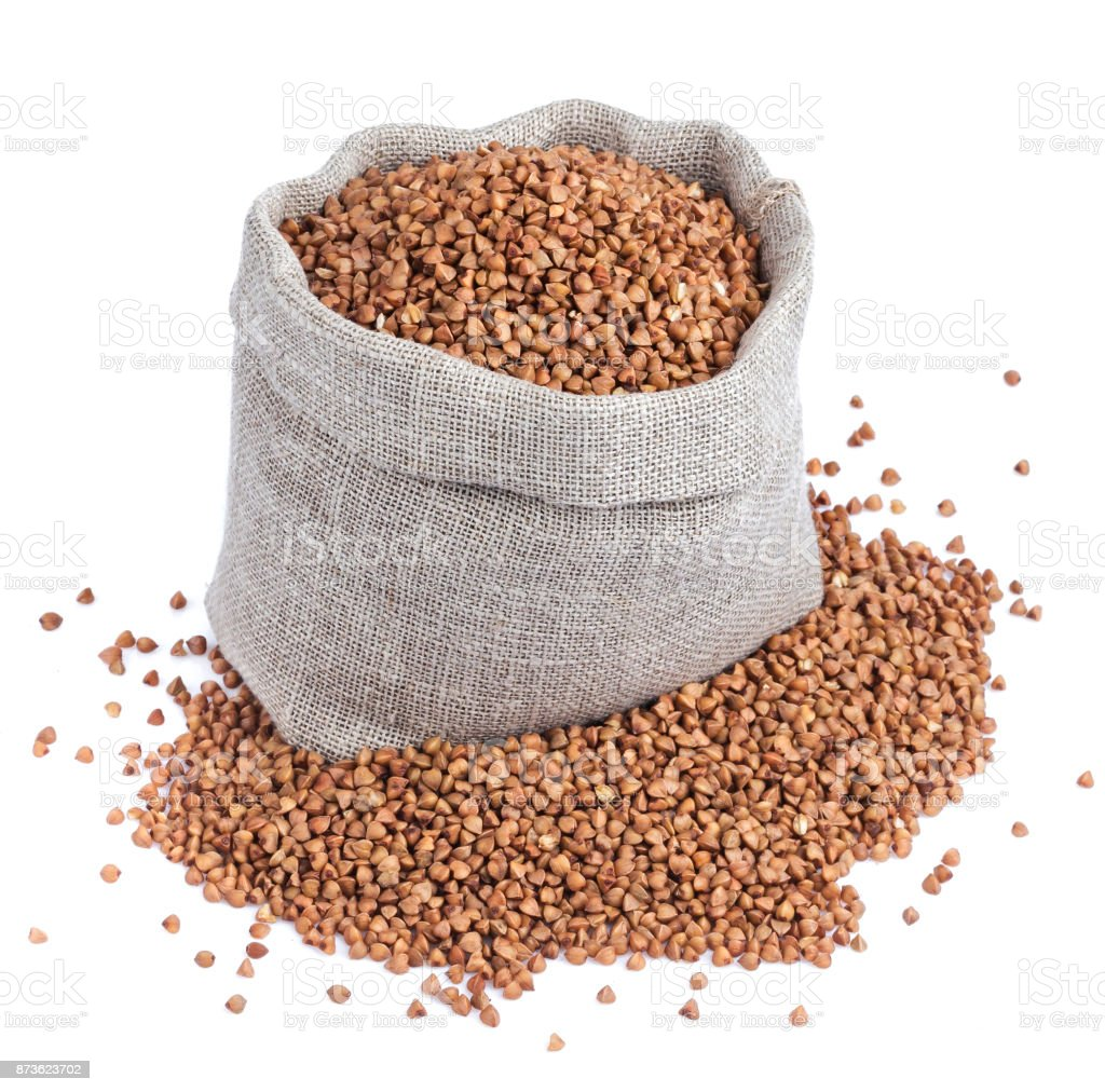Buckwheat in bag isolated on white background. Closeup stock photo