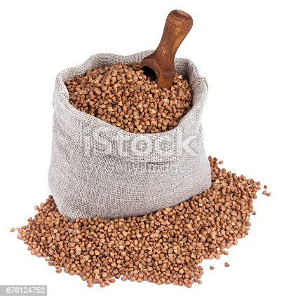 istock Buckwheat in bag isolated on white background. Closeup 876124752