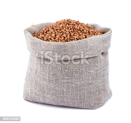istock Buckwheat in bag isolated on white background 908259060