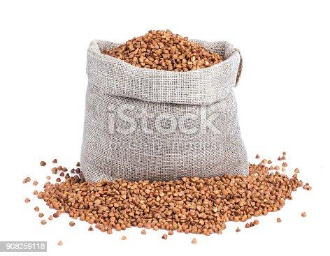 istock Buckwheat in bag isolated on white background 908259118
