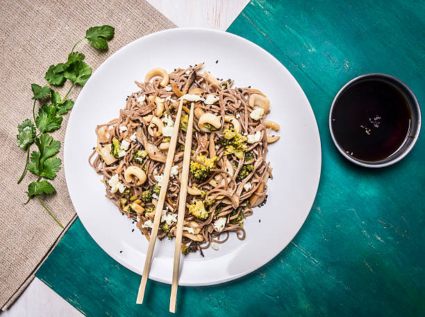Buckwheat noodles squid and seafood  white plate chopsticks top view stock photo