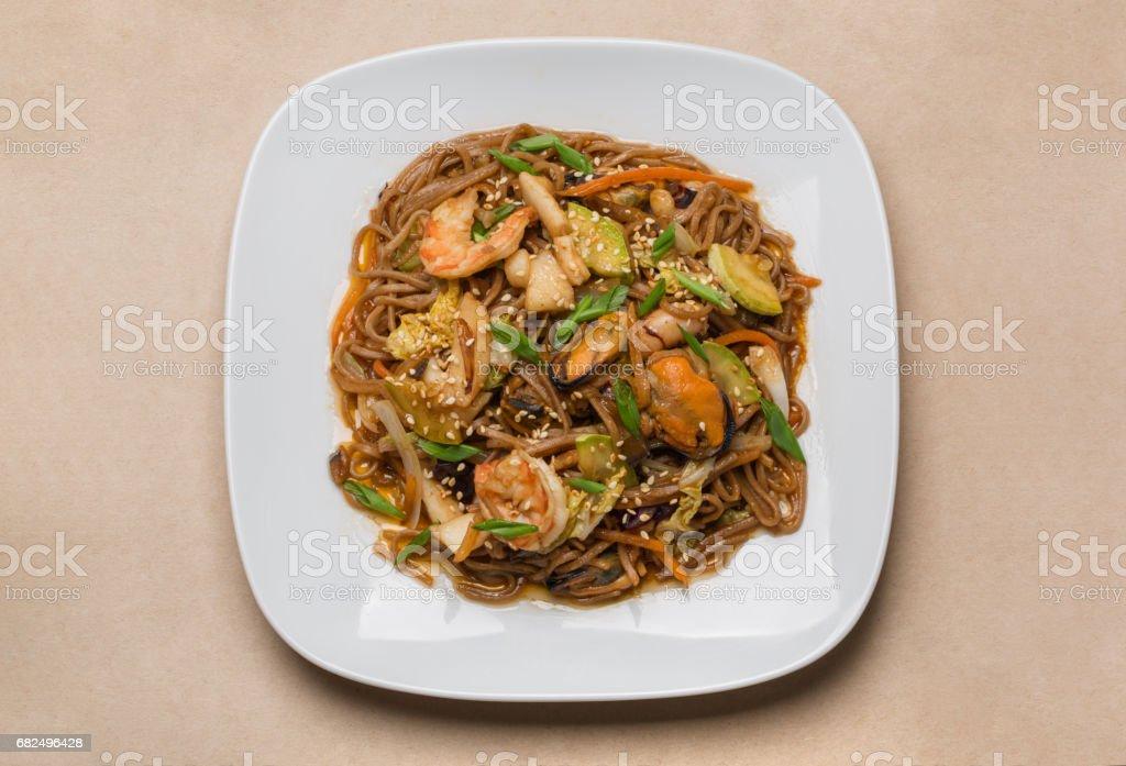 buckwheat noodles with seafood on white plate foto de stock libre de derechos