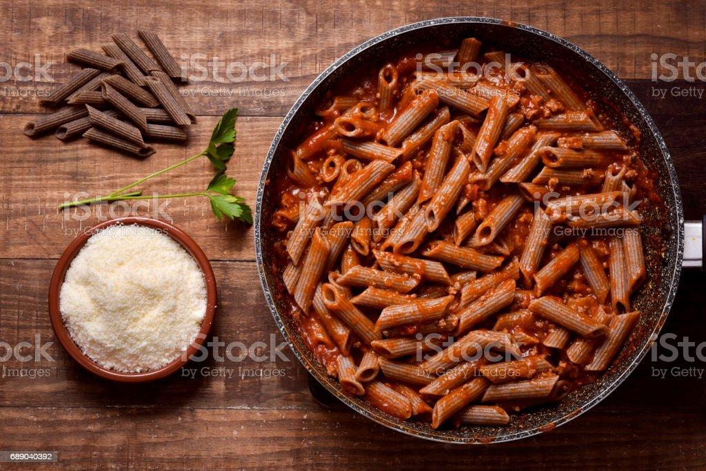 buckwheat penne rigate alla bolognese stock photo