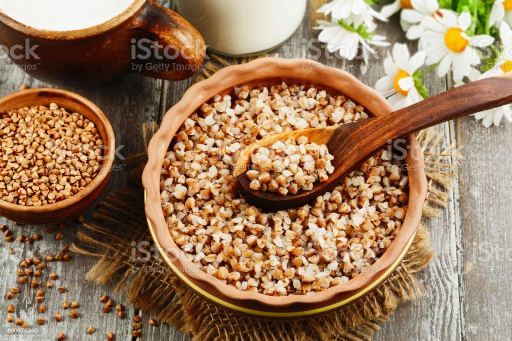 Buckwheat porridge in the ceramic pot stock photo