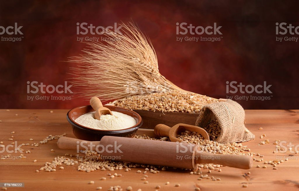 buckwheat with wheat flour and ears stock photo