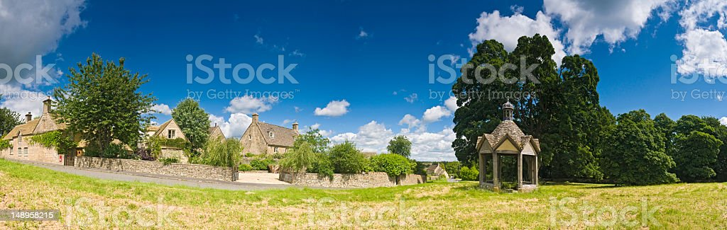Bucolic pastoral village green panorama royalty-free stock photo