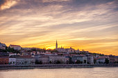 Pest district at sunset in front of danube river, Budapest, Hungary