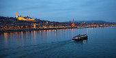 Danube riverbank - Matthias church and Fishermen's Bastion at winter night in Budapest, Hungary.