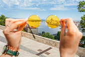Budapest city view through yellow hipster sunglasses
