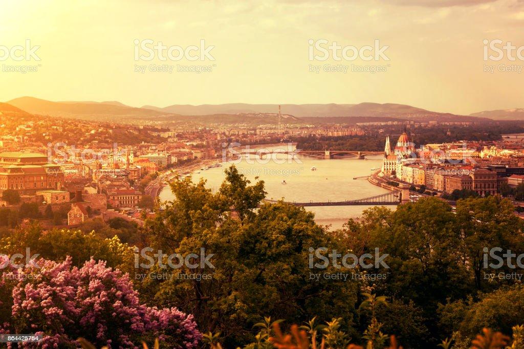 Budapest cityscape with Hungarian Parliament and Szechenyi Chain Bridge at sunset stock photo