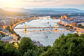 Aerial landscape view on the illuminated city during the twilight in Budapest, Hungary