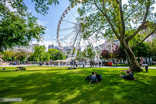 Budapest,Hungary 02 May 2019 : Budapest Eye with many people in the meadow on a spring day