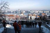 Budapest, Hungary - December 8, 2019: Tourism at Fisherman's Bastion (hungarian: Halászbástya) on a snowy winter day.