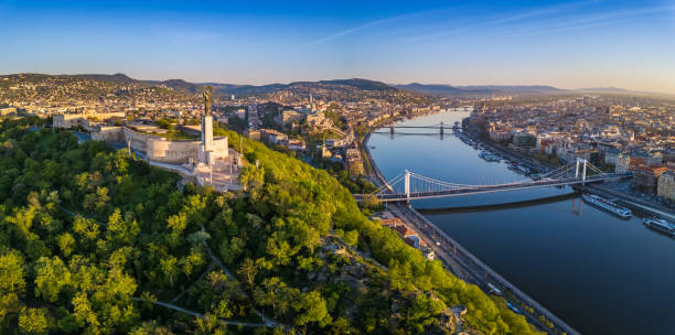 Budapest, Hungary - Aerial panoramic skyline view of Budapest at sunrise. This view includes the Statue of Liberty, Elisabeth Bridge and Szechenyi Chain Bridge stock photo