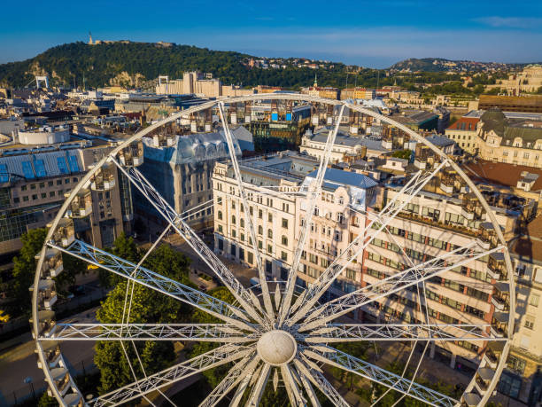 Budapest, Hungary - Aerial view of ferris wheel at Elisabeth Squaer at sunrise with Statue of Liberty stock photo