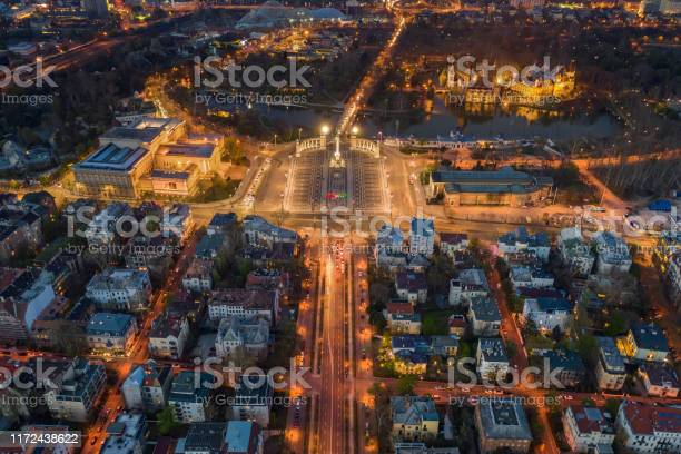 Photo of Budapest, Hungary - Aerial view of illuminated Heroes' square at dusk with City Park, Szechenyi Thermal Bath