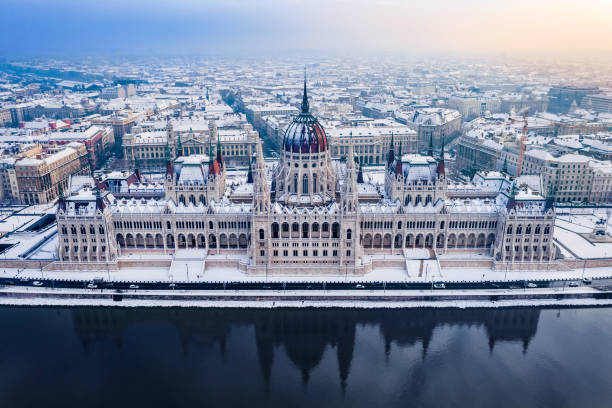 Budapest, Hungary - Aerial view of the beautiful snowy Parliament of Hungary and skyline of Pest at winter time stock photo