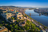 Budapest, Hungary - Beautiful aerial skyline view of Budapest at sunrise with Szechenyi Chain Bridge over River Danube, Matthias Church and Parliament of Hungary