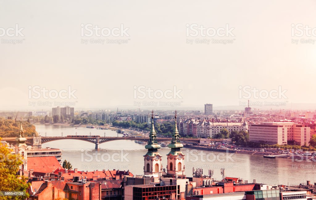 Budapest, Hungary. Beautiful, morning view of the Danube River, Margaret Bridge and Inner Parish Church. Image filtered with cross processed. stock photo