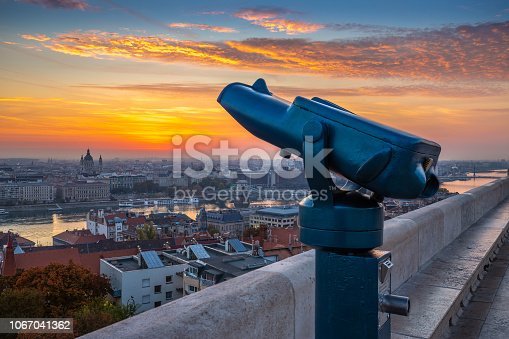 istock Budapest, Hungary - Blue binoculars with the view of Pest with St. Stephen's Basilica, Szechenyi Chain Bridge and beautiful sky and clouds 1067041362