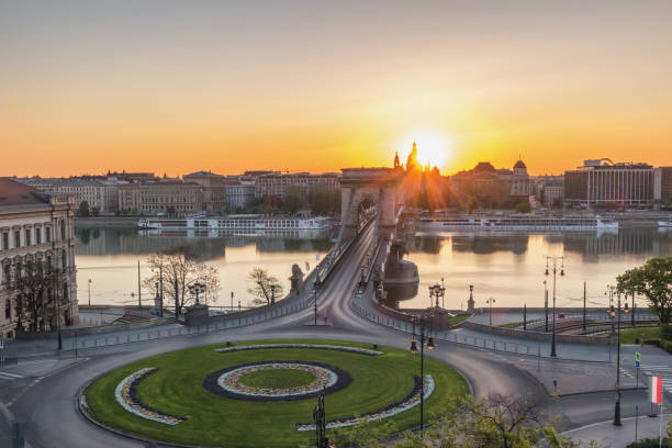 Budapest Hungary, city skyline sunrise at Danube River with Chain Bridge and St. Stephen's Basilica