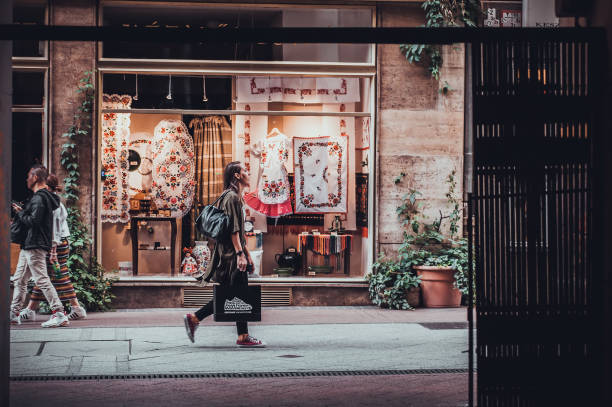 Budapest, Hungary -July 12th, 2018:  Young girl walking through the colorful streets of Budapest full of shops stock photo