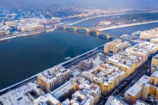 Budapest, Hungary - Snowy rooftops of Budapest with Margaret Bridge and Margaret Island at background stock photo
