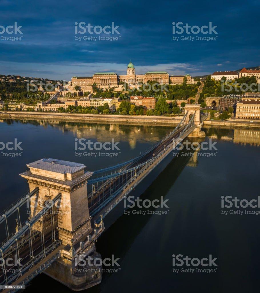 Budapest, Hungary - Sunrise over Szechenyi Chain Bridge with Buda Castle Royal Palace at background stock photo