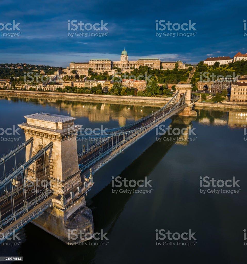 Budapest, Hungary - Sunrise over Szechenyi Chain Bridge with Buda Castle Royal Palace stock photo