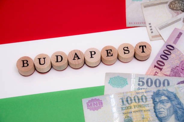 Budapest - Hungary with local currency on flag stock photo