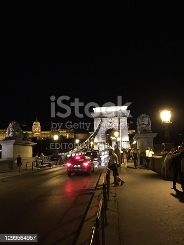 Popular chain bridge at the Donau river illuminated at night in Budapest in Hungary August 14,2016