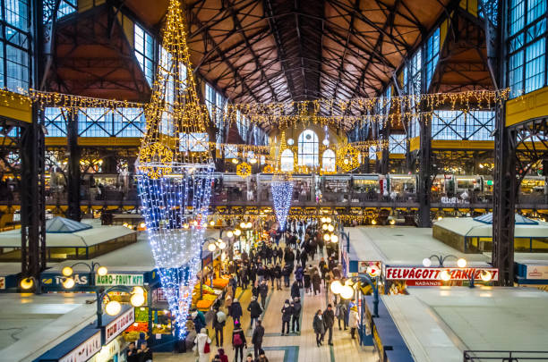 Budapest Market Hall at Christmas Budapest, HU - Jan 05, 2019: People shopping for the holidays at the main market hall in Budapest, Hungary. market hall stock pictures, royalty-free photos & images