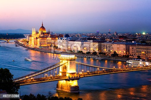 The Hungarian Parliament and the Chains Bridge in Budapest at sunset.